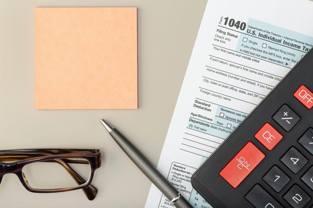 Individual Tax Return Form on table