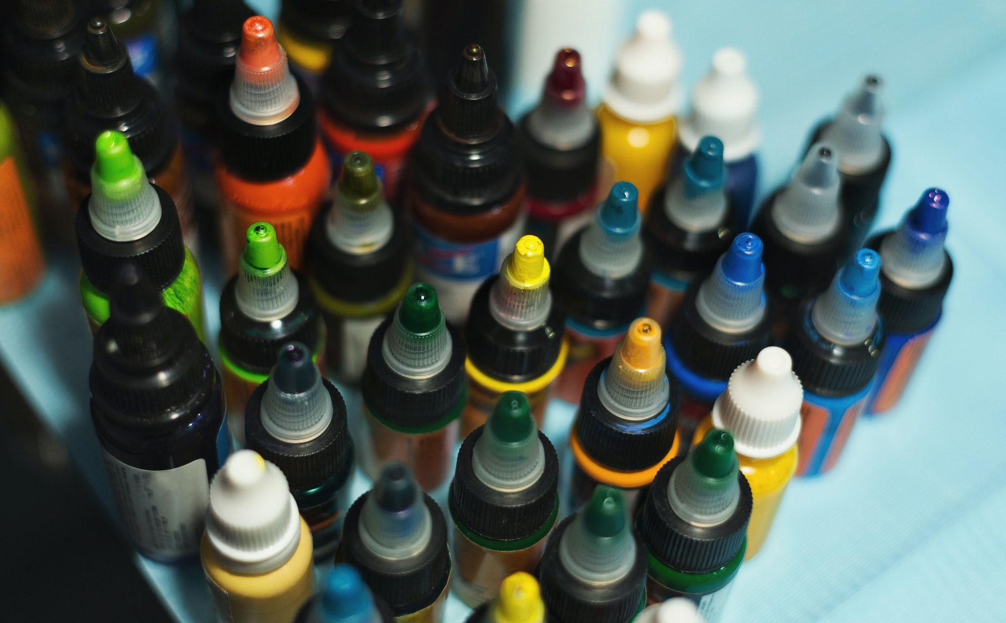 Multiple bottles with colorful inks for tattoo